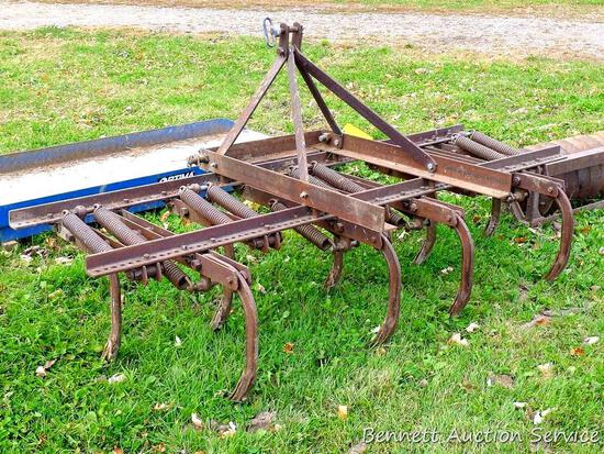 "Three-point spring loaded cultivator/chisel plow has category 3 pins and measures 86"" wide x"