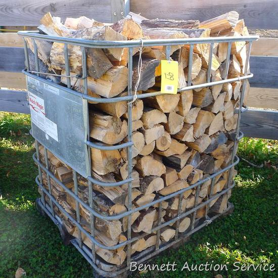"Metal crate filled with mixed firewood. Crate measures approx. 40"" x 46"" x 53""."