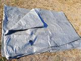 Large tarp. A few holes noted, but would do a good job covering a wood pile. Approx 14' x 28'.