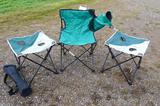 Two folding Pinnacle camp tables and a couple of folding chairs. One chair is sturdy but has a