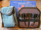 Bushnell case, metal Johnson & Johnson first aid kit, more. First aid kit is approx 11