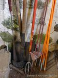 Fiberglass and steel fence posts; flat blade shovel with wooden handle; weed cutter; lawn edger;