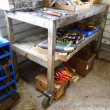 Very heavy duty steel work table with lower shelf on 6