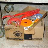Full box of Champion sporting clays; another box of clays 2/3 full; 3 hand clay throwers; pkg. of 6