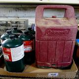 No shipping. Five 16 oz. propane fuel canisters; Coleman lantern case is 8