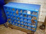 Metal storage cabinet has 40 compartments and is 12