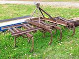 Three-point spring loaded cultivator/chisel plow has category 3 pins and measures 86