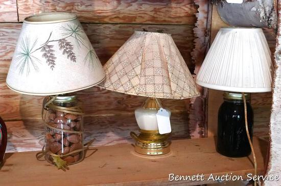 Three small table lamps, 2 have a quart jar base with maple syrup in one and nuts in other; lamp