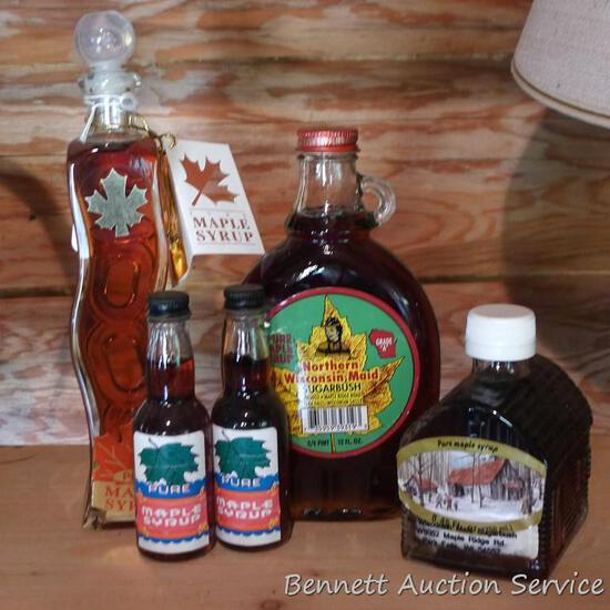 Various sized bottles of maple syrup; largest is 12 oz.