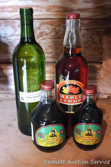 Three bottles of maple syrup and 1 bottle of apple wine from Alidon Winery, 2014; we think the wine