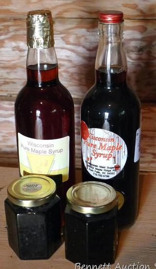 Two bottles of maple syrup and 2 jars of maple jelly; we think the jars of syrup are approximately