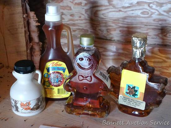 Four bottles of maple syrup in various shaped bottles; bottles appear to be 1/2 pint to 1 pint