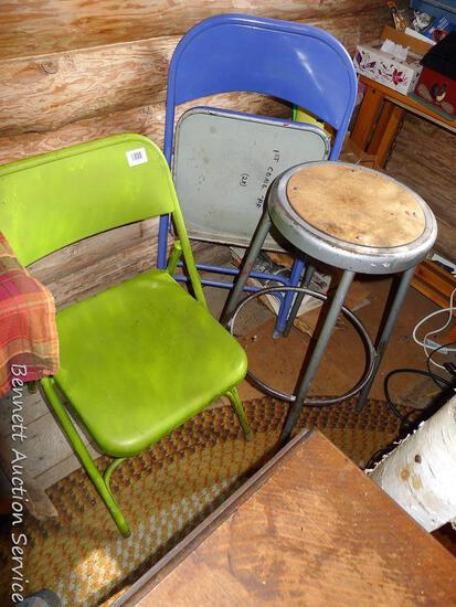 """Two metal folding chairs and sturdy metal stool; stool measures 14"""" x 30"""" tall."""