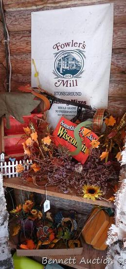 Two shelves of fall decorations including wooden pumpkin floral, small shelving unit, chickens,
