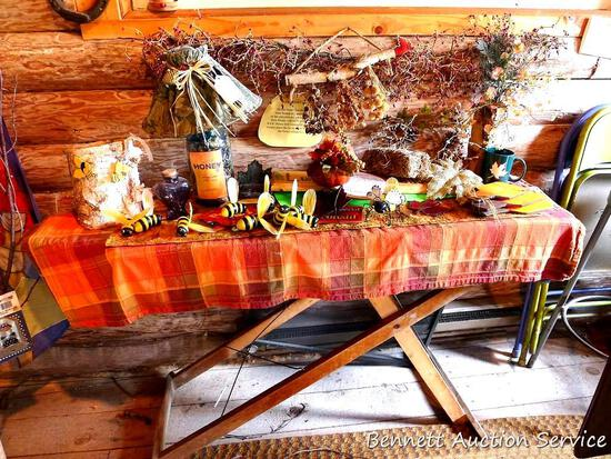 """Antique wooden ironing board, lamp, garland and other home decor; iron measures 54"""" x 15""""."""