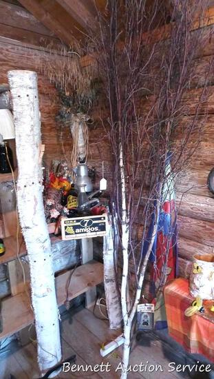 Birch branches and decorative flag with cardinal, grape crate with great graphics, oil lamp coffee