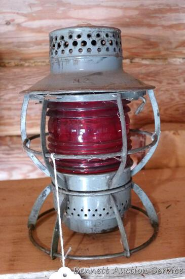 "Dressel, Arlington, N.J. railroad lantern with red globe, Pat. No. 215 7081; measures 6"" x 9"" tall."