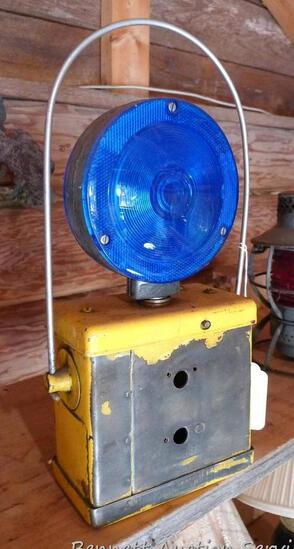 """Vintage work light with blue lens, base looks like it holds a battery; with handle it measures 7"""" x"""