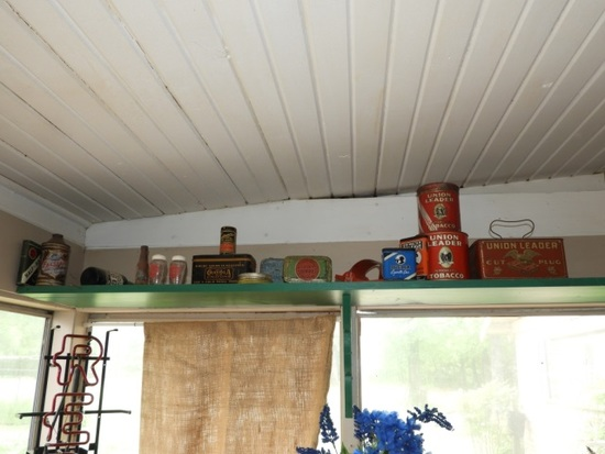 Collection of tins, mostly tobacco