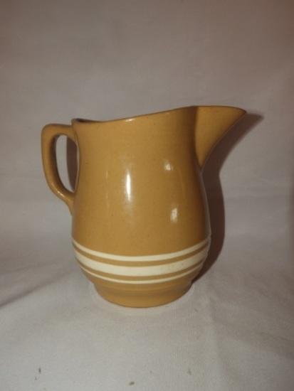 Gold-n-bake Wattware multi stripe Delaware pitcher