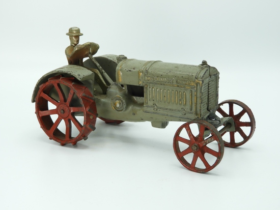 "Cast iron McCormick Dearing tractor w/ driver, 8""L"