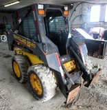New Holland LS 140 Skid Steer with Enclosed Cab!