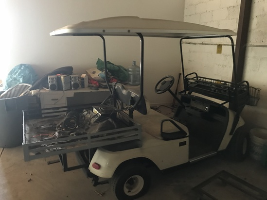 EZ-GO ELECTRIC GOLF CART WITH CHARGER (LOCATED IN NORTH MIAMI BEACH, FL)