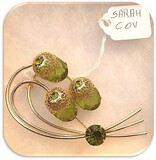 Vintage Sarah Coventry Brooch with Peridot Pronged Stones