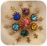 Vintage Brooch with Green, Blue, Amethyst, and Pink Rhinestones