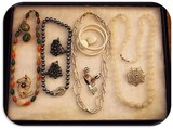 Lot of Necklaces, Earrings, Bracelets and Brooches with Beads, Milk Glass, and Rhinestones.