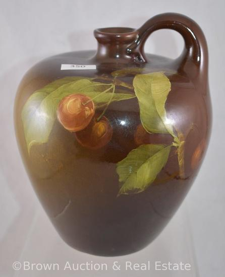 "Mrkd. Weller Louwelsa 7""h handled jug decorated with cherries, artist signed Mitchell"