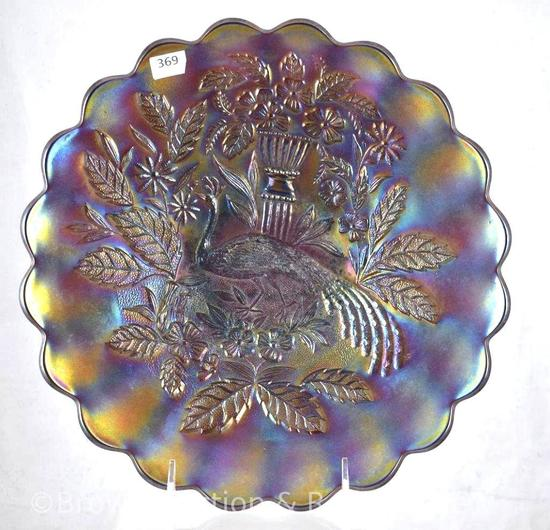 """Carnival Glass Peacock and Urn 10.5""""d chop plate, purple"""