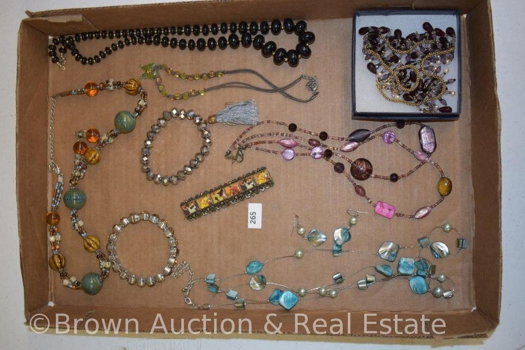 Box of assorted costume jewelry incl. necklaces and bracelets