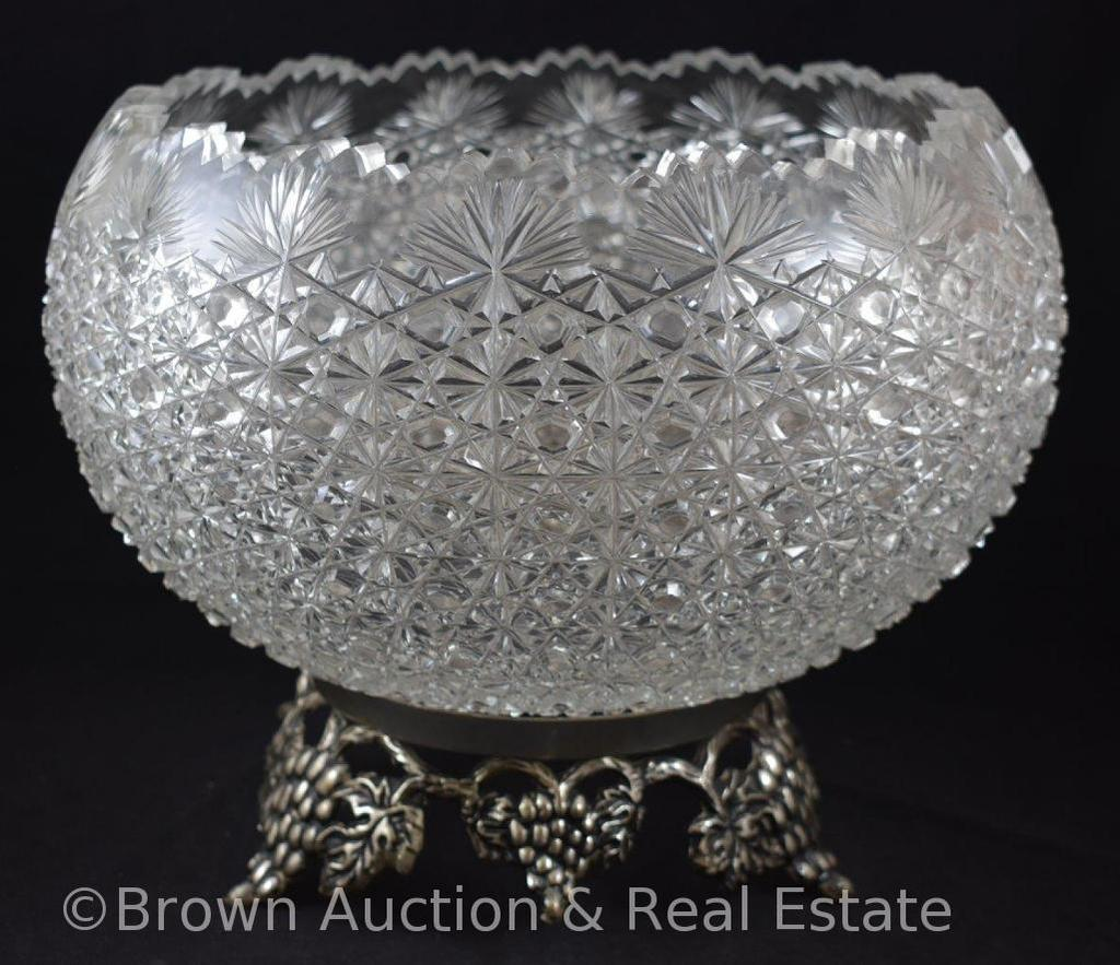 Large Cut Glass punch bowl on silver ftd. Decorative base
