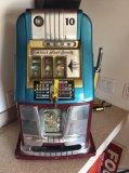 Mills Black Beauty 10 cent slot machine with keys.