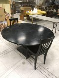 Large round wood table and two chairs. Table 29