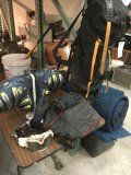 Lot of snow ski items. Boots with stand, gloves, bags etc