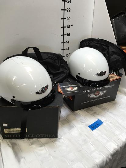 Harley Davidson Helmets 1 Medium and 1 XXL with tags and storage bags.