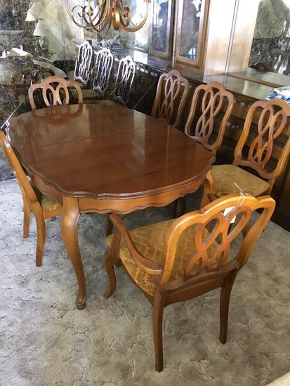 Vintage Dining table and 6 chairs with leaf stored under table