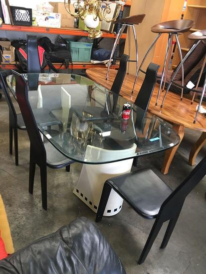 "Dining Set - 6 chair Glass top table sits on leather pedestals. Glass top 78"" x 42"""