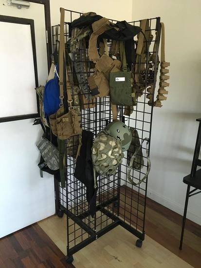 Rolling Grid display rack with assorted tactical gear ( vests, helmets, belts, etc)