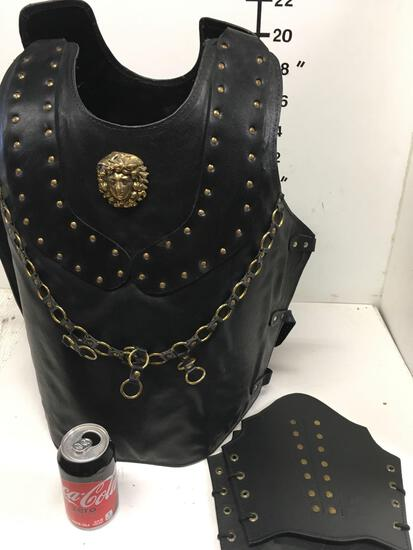 New leather like warrior vest with gold lion/ accents, with shields. size fits most
