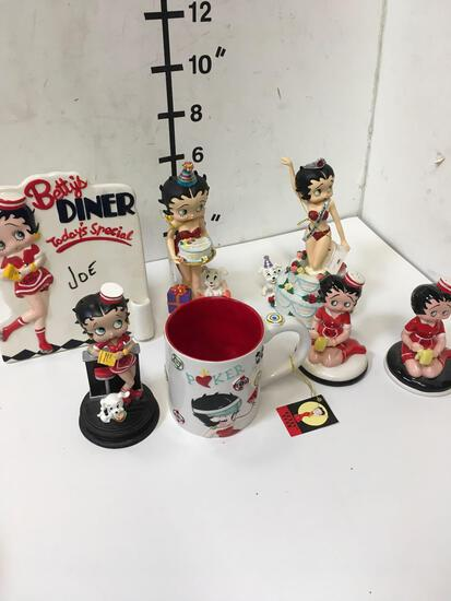 Collectible Betty Boop figurines, salt and pepper shakers, coffee cup, etc