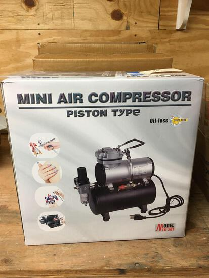 Air brush kit. New, 120 v, Mini air compressor piston type, model TC-20T