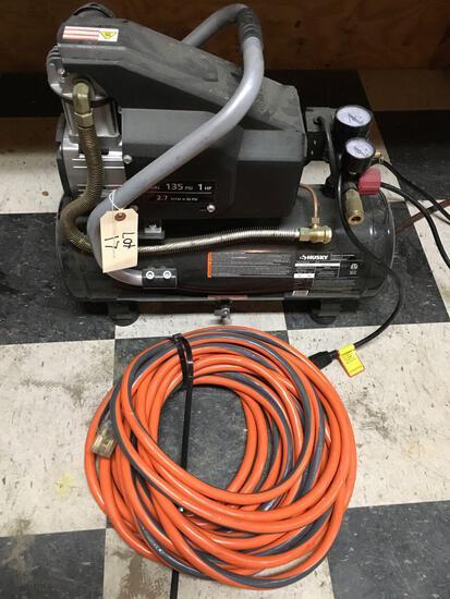 Husky 4 gal, 115v, 135 PSI, 1HP, air compressor with air hose.