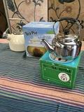 3 assorted tea kettles