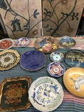 12 pieces. Assorted collectible/ decorative plates.