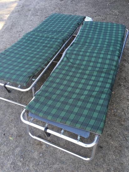 Folding cots with pads