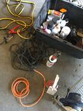 Grouping of Assorted sprays, liquids, electrical cord, charger cables, fire extinguishers, etc