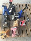 Grouping of assorted jack stand. 11 pieces